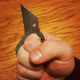 Hand holding straight knife