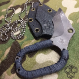 Hybrid knife and sheath on camo
