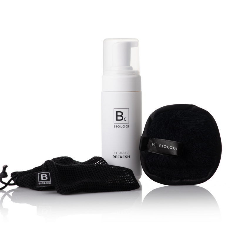 Biologi Serum Bc Refresh Cleanser 150ml next to black microfibre cloth and washbag.