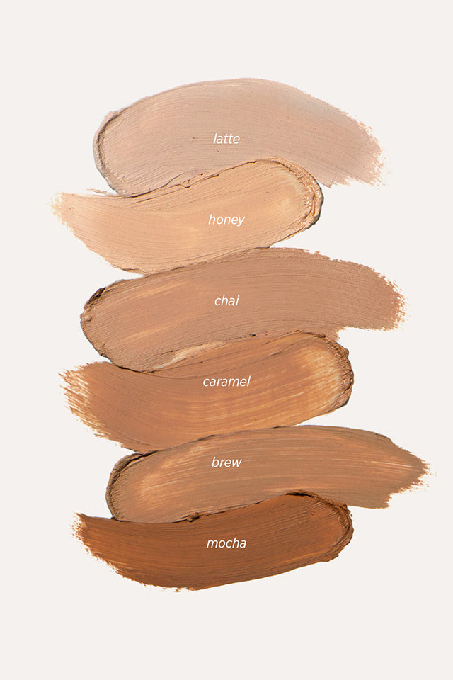 Ere Perez Arnica Concealer swatches in latte, honey, chai, caramel, brew and mocha.