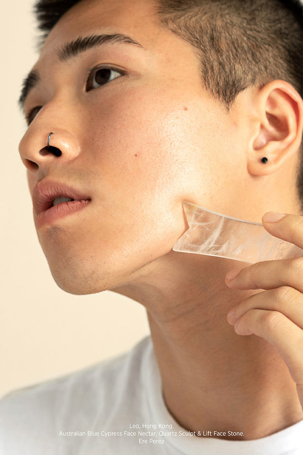 Man using Ere Perez Quartz Face Stone Sculpt and Lift on his jaw.