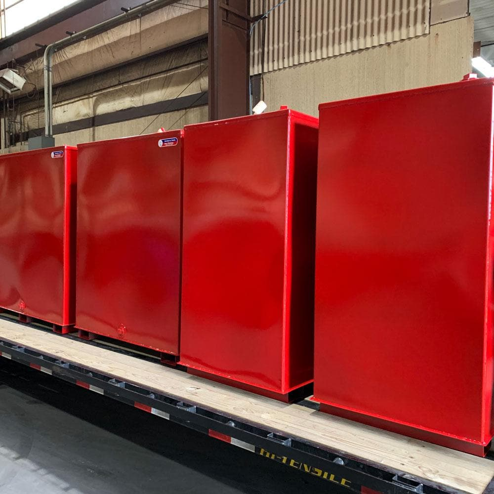 Red Steel Tanks Loaded on Truck
