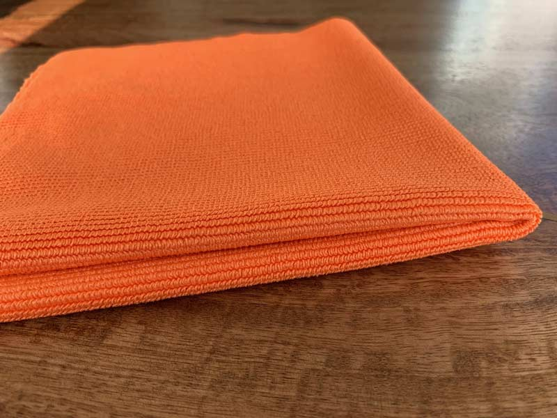microfiber utility towel cleans glass