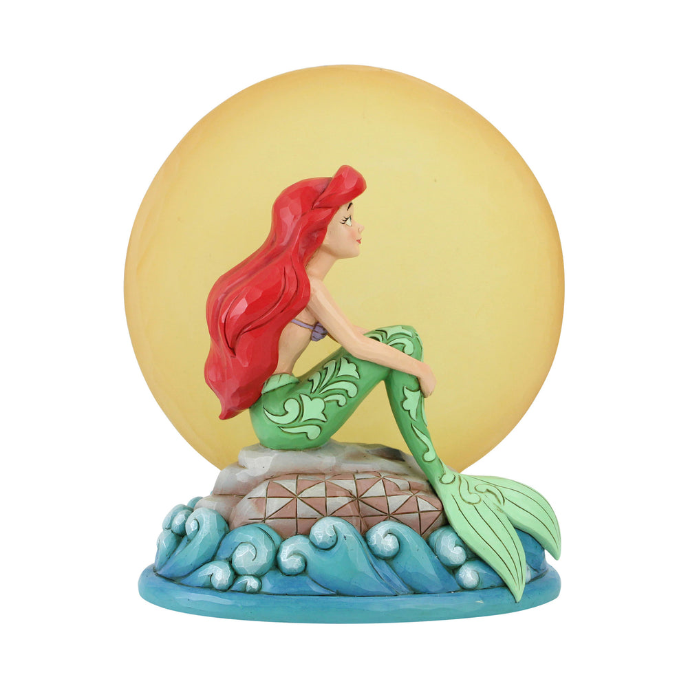 Ariel Sitting on Rock by Moon