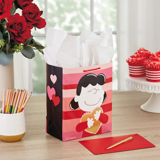 "9.6"" Peanuts® Lucy and Charlie Brown Valentine's Day Gift Bag"