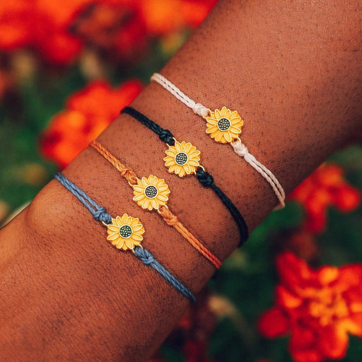Gold Sunflower Charm Bracelet in Blue Steel