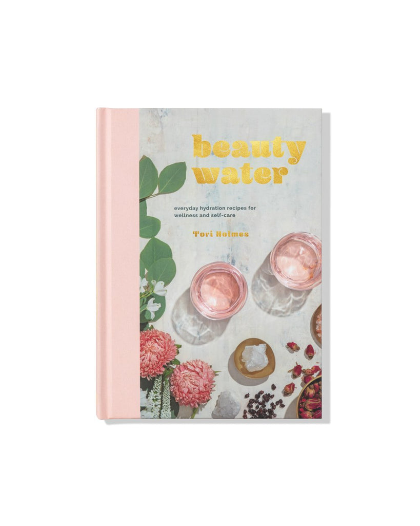 Beauty Water Book - Hardcover - No matter the medical text or ancient nutrition philosophy, all wellness regimens recognize the crucial role played by one simple element: water. This collection of 50 recipes teaches readers how to use herbs, oils, crystals, adaptogens and other supplements to turn hydration into a self-care ritual and water into a remedy.