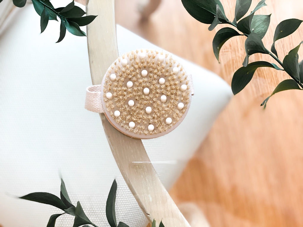 Made with polished bamboo wood, fine natural bristles, and a cotton strap or handle for easier grip, this natural body brush is a must have for your beauty and skincare arsenal. Body brushing works by supporting your lymphatic system and exfoliating away dead skin cells to reveal skin that's soft and smooth to the touch.