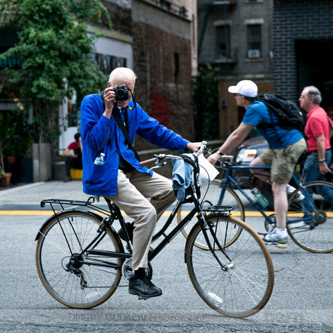 Bill Cunningham of New York Times suffers a stroke. Photo: Bill riding bike in summer.