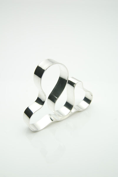 Orr silver ring for three fingers is an organic-abstract art object