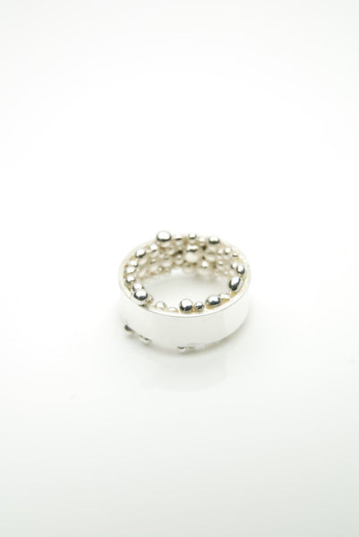 Hringur Ring by Orr is composed of a strong silver band set with countless round, pure silver units on the inside
