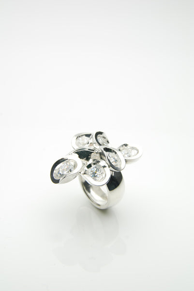 Photograph of Ringul ring with white zirconia stones in an organic setting