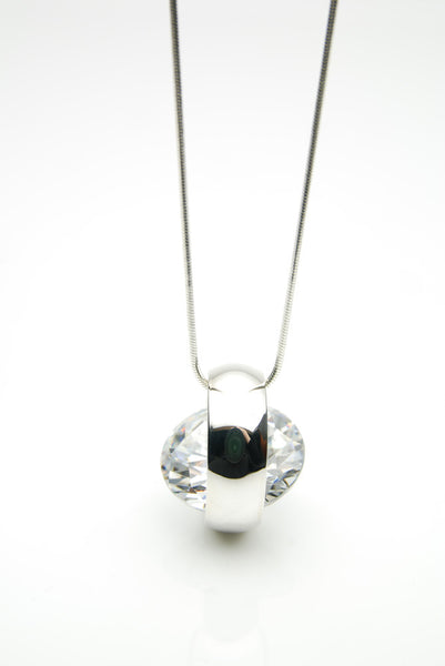 Laus handmade silver pendant is set with a white brilliant cut cubic zirconia