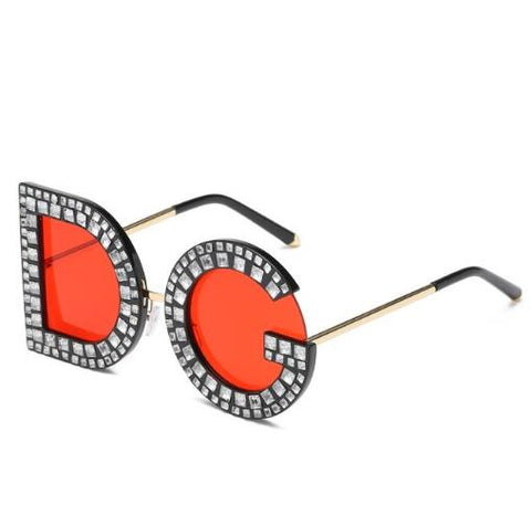 Sunglasses with the letters D & G as frames with red lenses