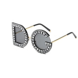 Sunglasses with the letters D & G as frames with grey lenses
