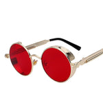 Gold circled framed sunglasses with red lenses