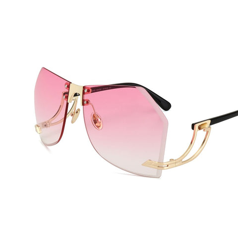 Pink lens sunglasses with gold frames that loop down and back up to the ear frame