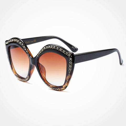 fancy cat eye black women's sunglasses with jewel decor on top and two toned lenses