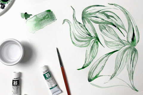 Watercolour painted green leaves on white background with paint tubes and paintbrush