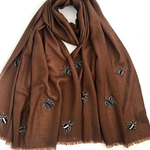hand beaded bugs on merino wool shawl brown
