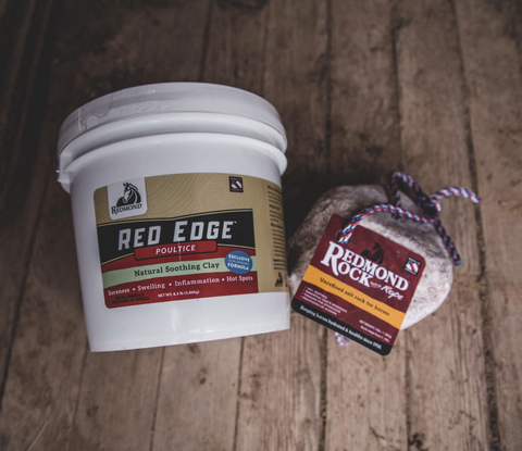 A bucket of Redmond Red Edge Poultice and a Redmond Rock on a Rope