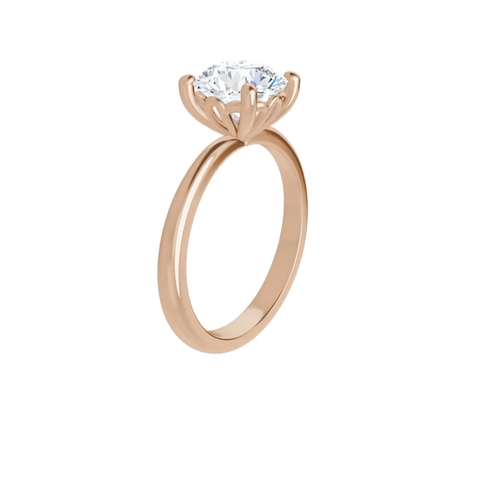 14k rose gold round brilliant cut moissanite ring with with decorative lotus inspired basket