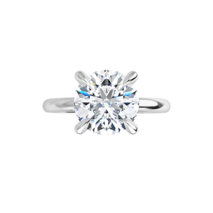 Jewel - 4-prong 14 k white gold round brilliant-cut moissanite solitaire with four tiger claw prongs