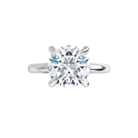 4-prong 14 k white gold round brilliant-cut moissanite solitaire with four tiger claw prongs