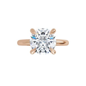 14k rose gold round brilliant cut moissanite ring with gallery and four tiger claw prongs