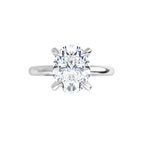 14 k white gold oval moissanite solitaire with gallery and fourtiger claw prongs