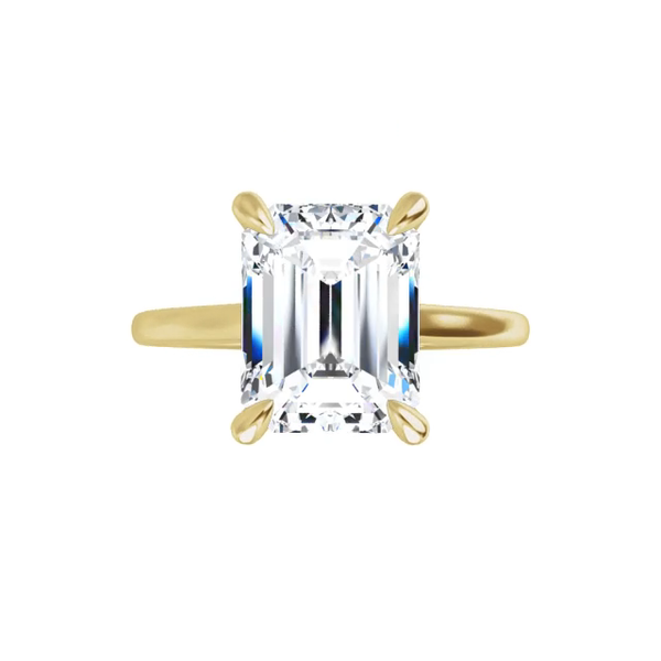Ava -14k yellow gold emerald cut moissanite ring with tampered shoulders gallery and four claw prongs