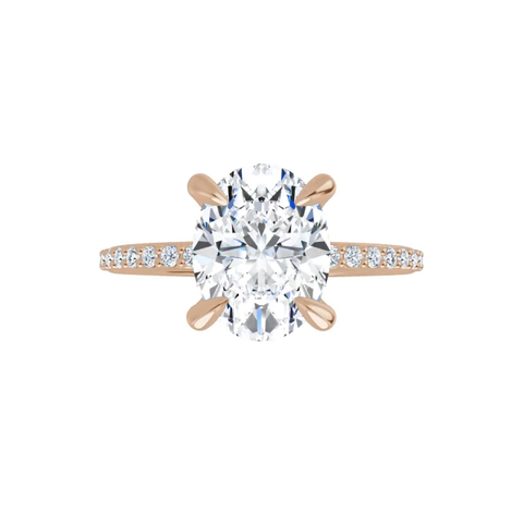 14k rose gold oval brilliant cut moissanite ring with lab diamond band and four tiger claw prongs
