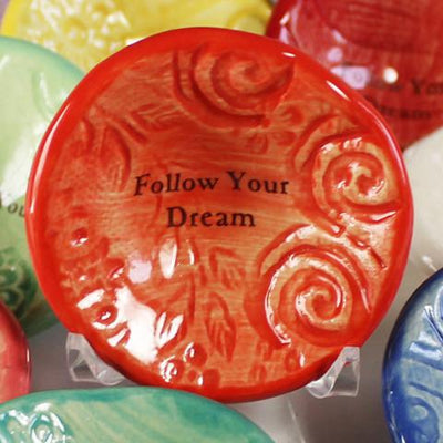 "Lorraine Oerth Giving Bowl with phrase ""Follow Your Dream"" in Coral Orange Glaze"