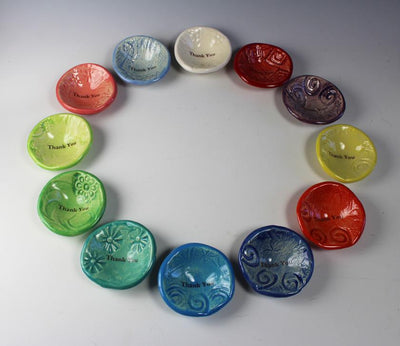 A circle of Giving Bowls by Lorraine Oerth showing the colors of the Jelly Bean Collection.