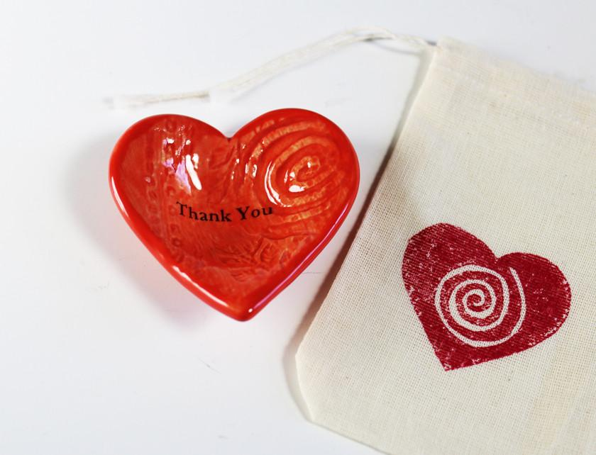 "A coral Giving Heart ""Thank You"" comes with a hand printed gift bag"