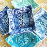 Mermaid dish handmade by Lorraine Oerth .