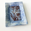 Handmade blue tray with abstract drawing of flower by Lorraine Oerth.