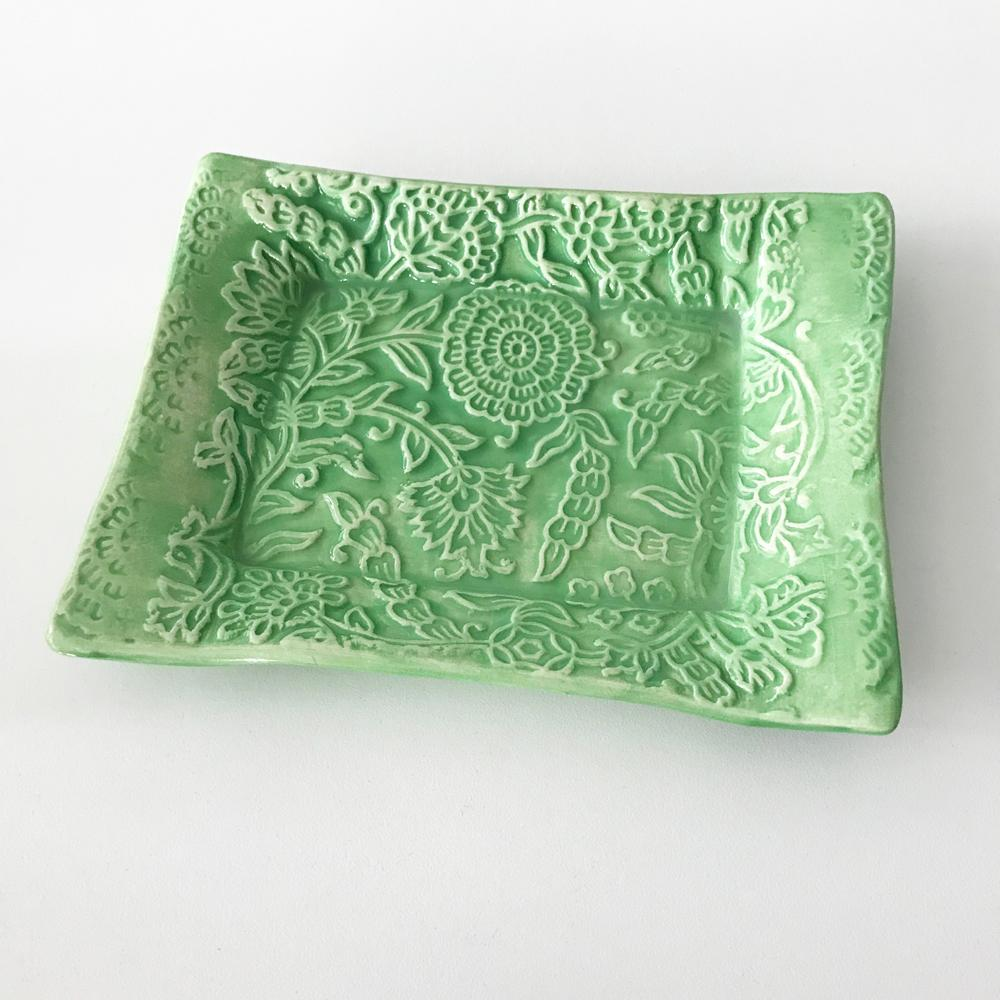 Handmade pottery tray by Lorraine Oerth in flower design.