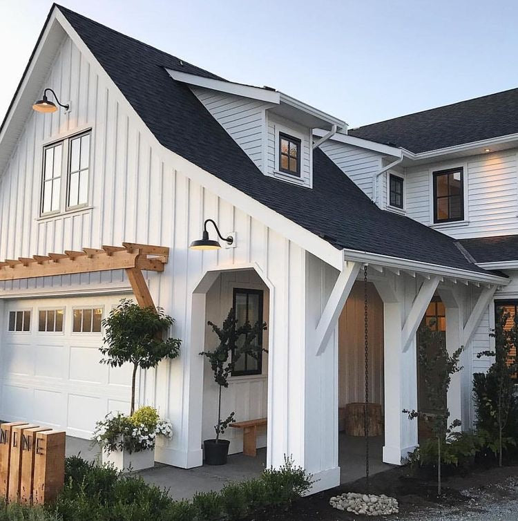 Enjoy outdoor country living with this white paneled home with natural wooden accents