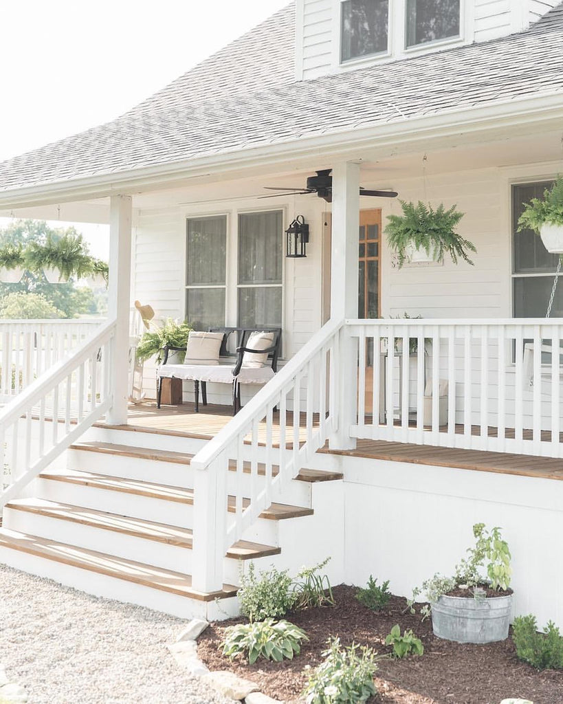 A relaxing daily getaway on the front porch of a white farmhouse