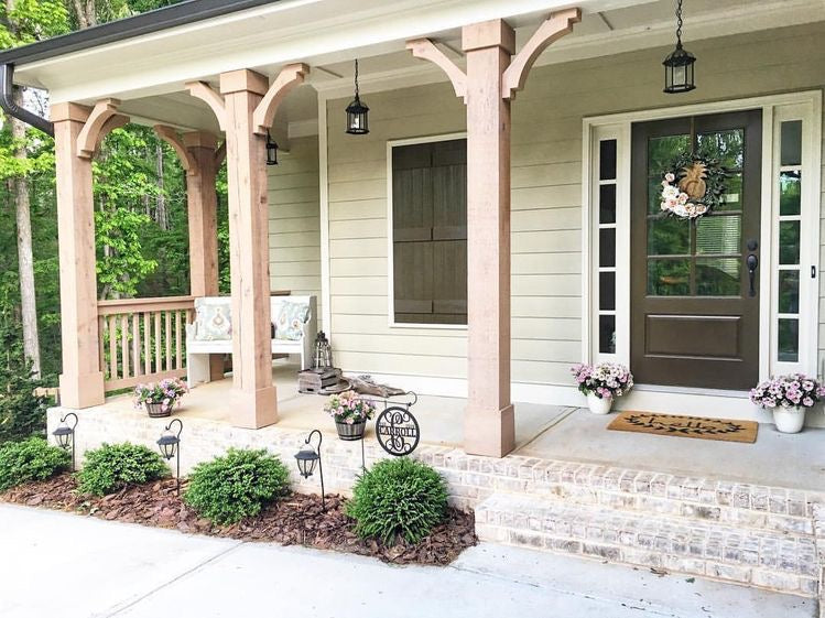 Beautiful wooden beams and railing on a farmhouse porch