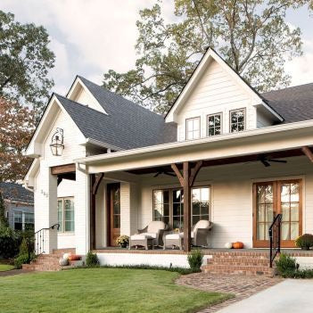A white modern farmhouse with a beautiful front porch