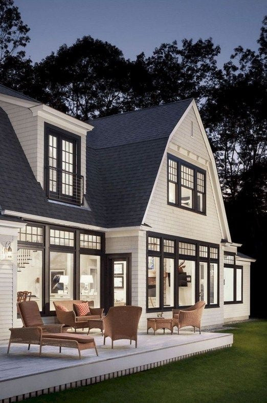 A cozy looking white modern farmhouse with dark accents