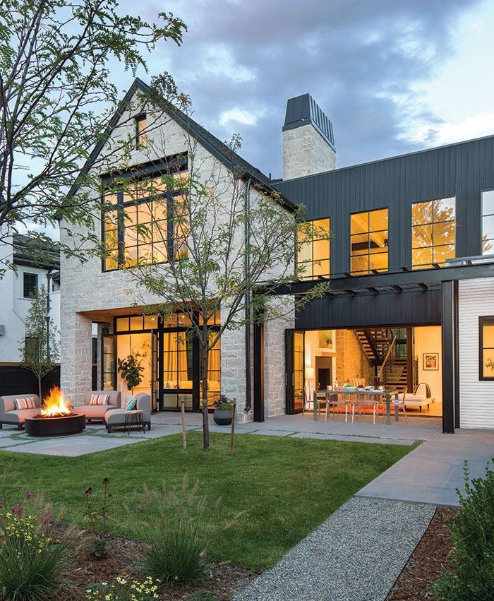 A multi level large modern farmhouse with beautiful outdoor living essentials
