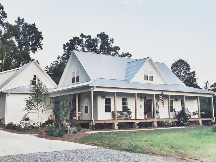 White country living farmhouse with a magnificent front porch