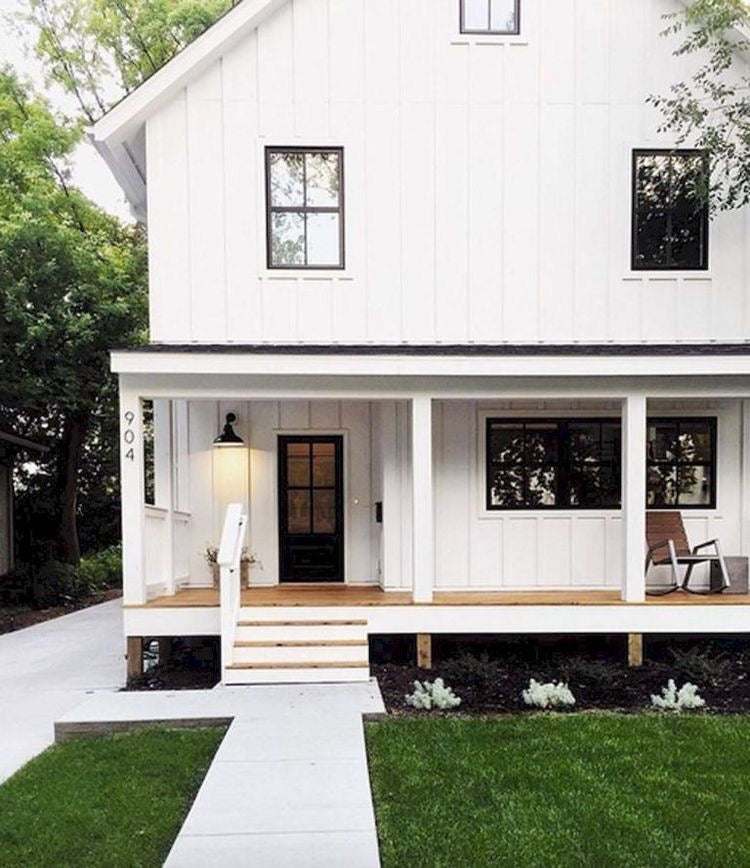 Cozy white paneling exterior on a modern farmhouse