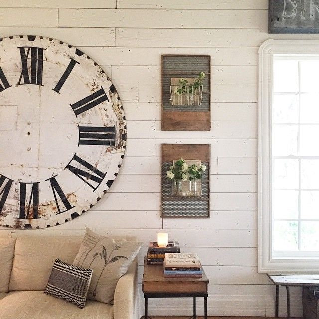 Two Hanging Planters in Frames next to Large Antique Rustic Wall Clock