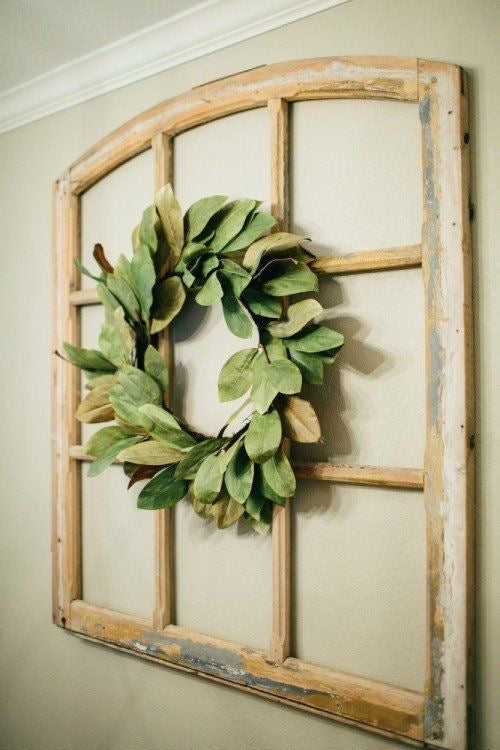 Open Paned Antique Window with Magnolia Wreath in the Center from Fixer Upper