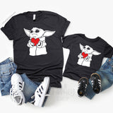 Valentine's Day Baby Yoda With Heart  T-shirt - Disney MatchingShirts, Disney Family Shirts, Disney Couple Shirts from The FMLY shop