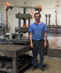 Yates Spence of Athena Skillets in his shop